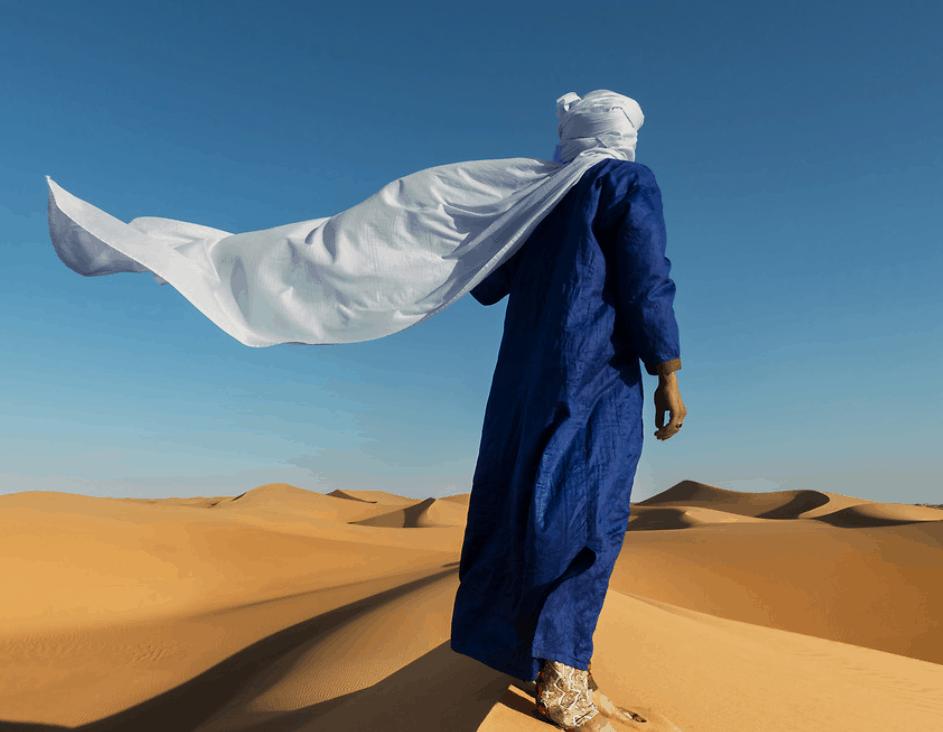 Man walking in the desert on desert tour